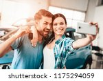 a man and a woman do selfie... | Shutterstock . vector #1175294059