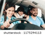 a woman is sitting at the wheel ... | Shutterstock . vector #1175294113