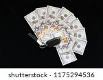car's ignition and 100 dollars | Shutterstock . vector #1175294536