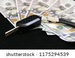 car's ignition and 100 dollars | Shutterstock . vector #1175294539