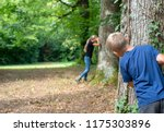 kids playing hide and seek in... | Shutterstock . vector #1175303896