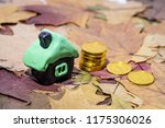 small house on maple leaves.... | Shutterstock . vector #1175306026