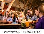 beautiful waitress carries a... | Shutterstock . vector #1175311186