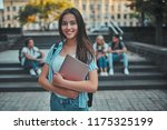 group of young people are... | Shutterstock . vector #1175325199