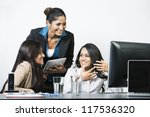 Group of happy Indian business women in a meeting at the office. - stock photo
