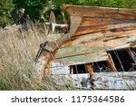wreck of a small boat with a... | Shutterstock . vector #1175364586