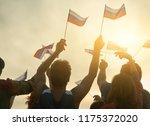 group of people waving russian... | Shutterstock . vector #1175372020