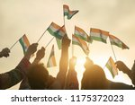 indian patriots with flags.... | Shutterstock . vector #1175372023