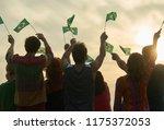 group of people waving... | Shutterstock . vector #1175372053