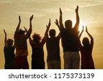 people raising hands up at the... | Shutterstock . vector #1175373139