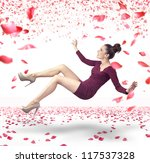 Stock photo attractive lady falling down over rose petals background 117537328