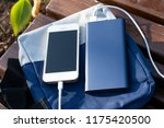 the power bank charges the... | Shutterstock . vector #1175420500