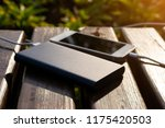 power bank charges the phone on ... | Shutterstock . vector #1175420503