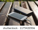 bank of power and phone on the... | Shutterstock . vector #1175420506