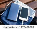 bank of power and phone on the... | Shutterstock . vector #1175420509