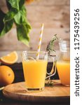 glass of fresh pressed orange...   Shutterstock . vector #1175439256