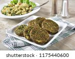 serving palet of spinach cakes... | Shutterstock . vector #1175440600