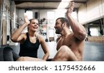 fit young couple in sportswear... | Shutterstock . vector #1175452666