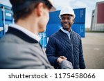 two smiling engineers wearing... | Shutterstock . vector #1175458066
