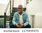 smiling young african... | Shutterstock . vector #1175459473