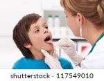 Say aaah - little boy at the physician checking his throat - stock photo