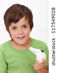 Boy with inhaler - respiratory illness - stock photo
