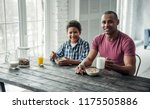 afro american father and son in ... | Shutterstock . vector #1175505886