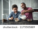 afro american father and son in ... | Shutterstock . vector #1175505889