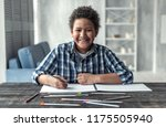 happy afro american boy is... | Shutterstock . vector #1175505940