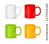 Set Of Colored Mugs On The...