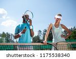 joyful tennis players are... | Shutterstock . vector #1175538340