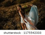 Small photo of Beautiful woman with bride dress . Sadness and melancholy
