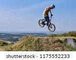 man on bmx bike performing jump ... | Shutterstock . vector #1175552233
