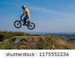 young man on bmx bike jump and... | Shutterstock . vector #1175552236