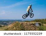 man in helmet on bmx bike... | Shutterstock . vector #1175552239