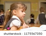 the girl is a first grader at... | Shutterstock . vector #1175567350