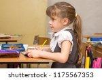 a girl first graders... | Shutterstock . vector #1175567353