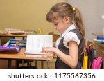 a little girl in a class... | Shutterstock . vector #1175567356
