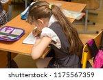 schoolgirl with a wrong posture ... | Shutterstock . vector #1175567359