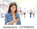 happy girl uses a smart phone... | Shutterstock . vector #1175580253