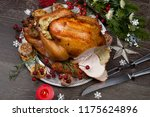 carving rustic style roasted... | Shutterstock . vector #1175624896