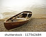 old rowboat at a lake near rome - stock photo