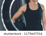 a woman holding a bottle of... | Shutterstock . vector #1175647516