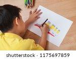 adorable boy doing homework ... | Shutterstock . vector #1175697859