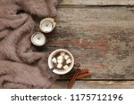warm soft blanket  cup of hot... | Shutterstock . vector #1175712196