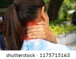 woman's neck pain she is using... | Shutterstock . vector #1175715163