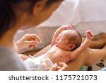 little cute newborn girl... | Shutterstock . vector #1175721073
