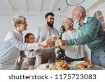 family gathered over christmas... | Shutterstock . vector #1175723083