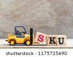 toy forklift hold letter block... | Shutterstock . vector #1175725690
