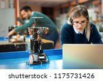 young woman engineer working on ... | Shutterstock . vector #1175731426
